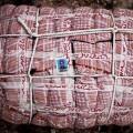 """© Francesco Giusti. Foto di identità allegata alla borsa di un lavoratore migrante in fuga dalla Libia. Posto di frontiera di Ras al-Jedir, confine tra Libia e Tunisia, Marzo 2011. Dalla serie: """"In Case Of Loss"""", 2011"""
